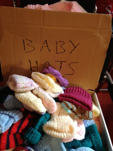 Baby hats being sorted at our centre