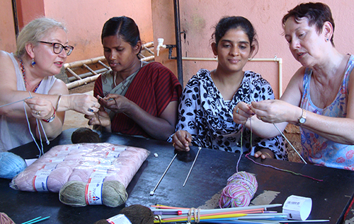 Girls being taught how to knit