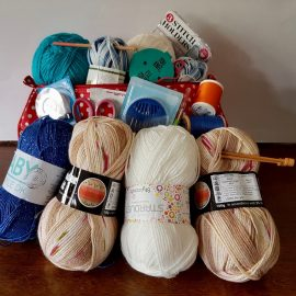A bundle of yarn, needles and haberdashery items for refugees