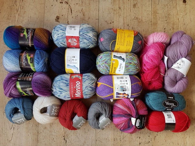 A raffle prize consisting of 18 balls and skeins of sock wool