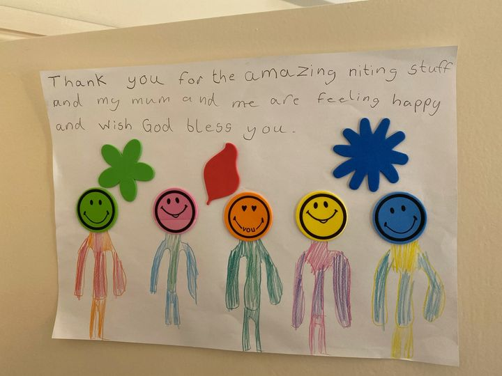 A thank you note made by a child in a women's refuge who received knitting from Knit for Peace.