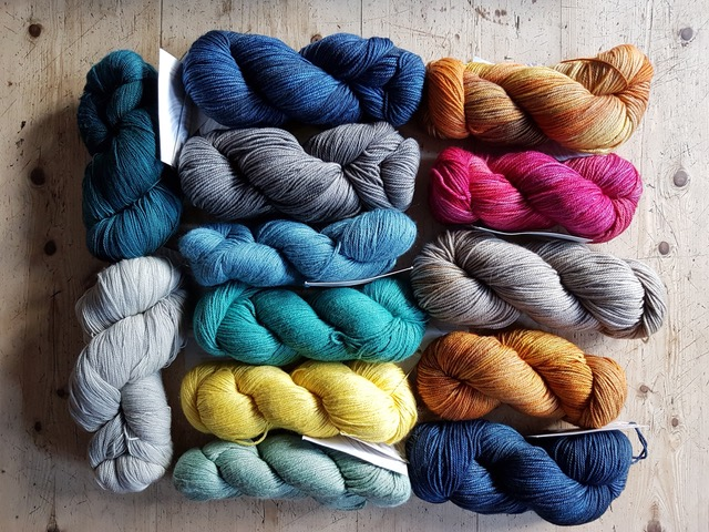 A raffle prize consisting of 13 skeins of yarn from the Yarn Collective